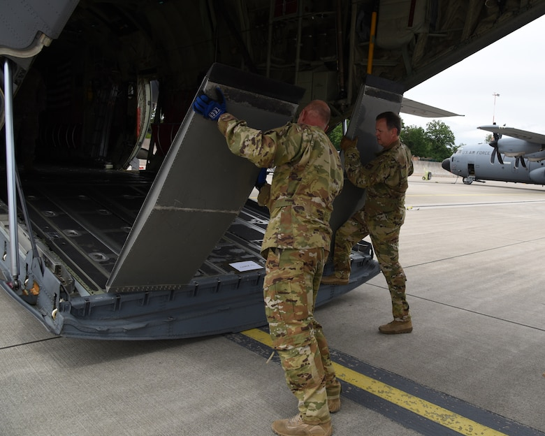 Senior Master Sgts. Dave Cooper and John Kittrell, loadmasters with the 815th Airlift Squadron, 403rd Wing, move ramps of the cargo section to load ground mobility vehicles for exercise Swift Response 19, June 14, 2019. The exercise is one of the premier military crisis response training events featuring high readiness airborne forces from eight NATO nations. Activities include intermediate staging base operations, multiple airborne operations, and several air assault operations. The Swift Response exercises have had great success in creating a foundation for the strong relationships we share with several European allies and partners today. (U.S. Air Force photo by Master Sgt. Jessica Kendziorek)