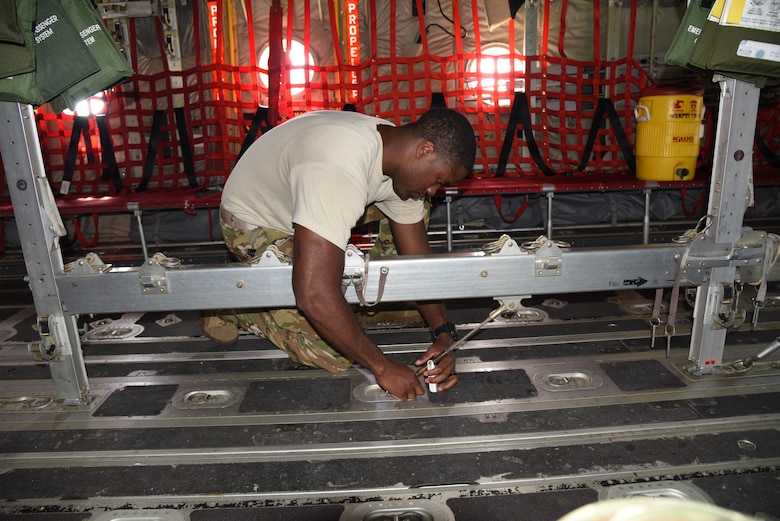 Tech. Sgt. Gary Bryant, a loadmaster with the 815th Airlift Squadron, 403rd Wing, installs the seating on the C-130J in preparation for paratroopers to use for exercise Swift Response 19, June 12, 2019. The exercise is one of the premier military crisis response training events featuring high readiness airborne forces from eight NATO nations. Activities include intermediate staging base operations, multiple airborne operations, and several air assault operations. The Swift Response exercises have had great success in creating a foundation for the strong relationships we share with several European allies and partners today. (U.S. Air Force photo by Master Sgt. Jessica Kendziorek)