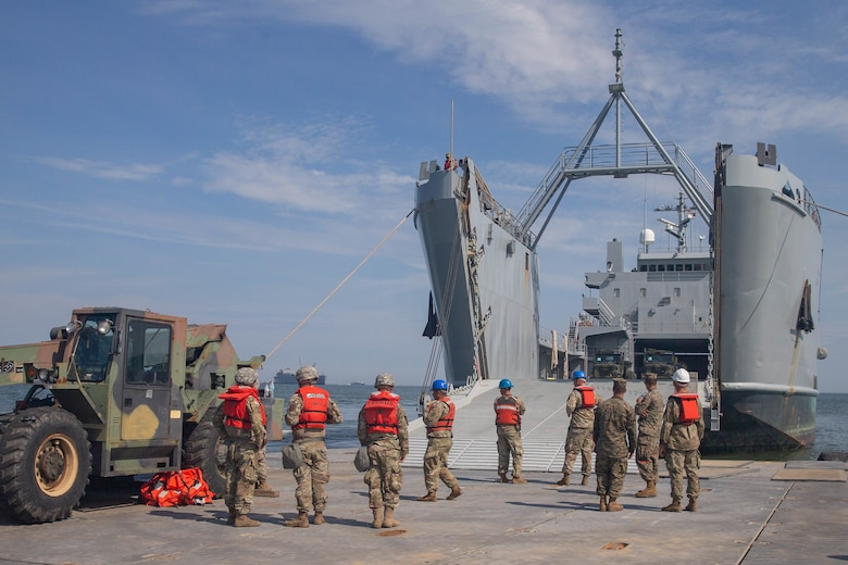 U.S. Soldiers with 11th Transportation Battalion, 7th Transportation Regiment, prepare to off load a landing craft, utility from the USNS Watkins (T-AKR-315) as part of exercise Resolute Sun at Fort Story, V.A., June 18, 2019. U.S. Marines participated in the exercise to increase combat operational readiness in amphibious and prepositioning operations while conducting joint training with the U.S. Army during a joint logistics over the shore scenario. (U.S. Marine Corps photo by Lance Cpl. Scott Jenkins)