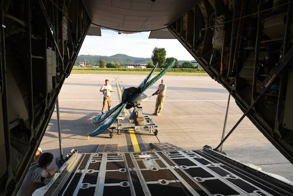 Senior Master Sgts. Eric Gassiott and John Kittrell, loadmasters for the 815th Airlift Squadron from the 403rd Wing, load a propeller onto the C-130J at the conclusion of exercise Swift Response 19, June 19, 2019. The exercise is one of the premier military crisis response training events featuring high readiness airborne forces from eight NATO nations. Activities include intermediate staging base operations, multiple airborne operations, and several air assault operations. The Swift Response exercises have had great success in creating a foundation for the strong relationships we share with several European allies and partners today. (U.S. Air Force photo by Master Sgt. Jessica Kendziorek)