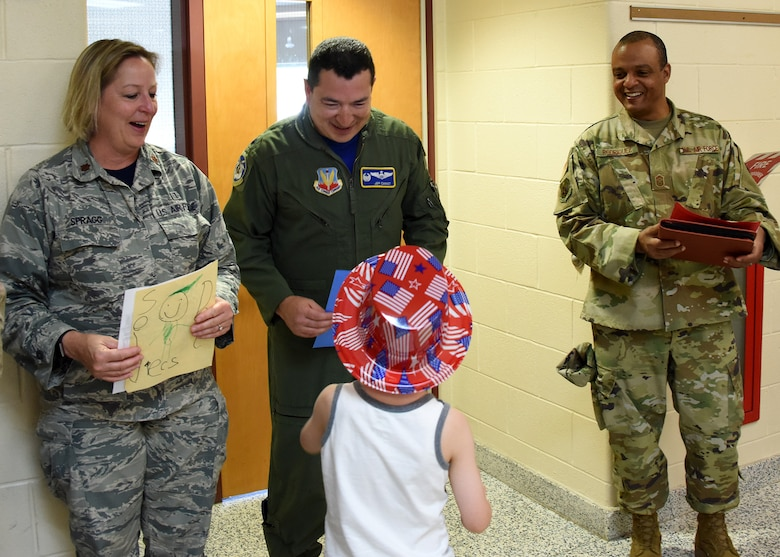 Airmen from the 106th Rescue Wing honored at a local school for Flag Day
