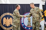 Air Force Gen. Joseph L. Lengyel, chief of the National Guard Bureau, congratulates Army Lt. Gen. Daniel Hokanson, who became of the Army National Guard in a ceremony June 21, 2019, at the Herbert R. Temple Army National Guard Readiness Center, Arlington Hall Station in Arlington, Virginia.