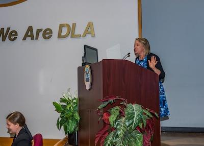 Woman speaks behind podium