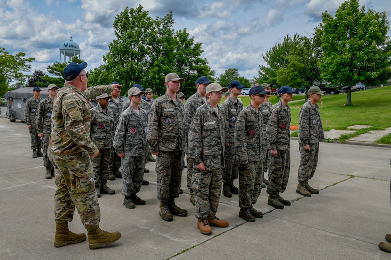 U.S. Air Force Senior Airman Alec Kovac, a 910th Airlift Wing Junior Reserve Officer Training Corps leadership camp instructor, instructs cadets to stand at the position of attention on June 14, 2019 at Youngstown Air Reserve Station.