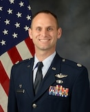 Lt Col Thackaberry official photo with American flag background
