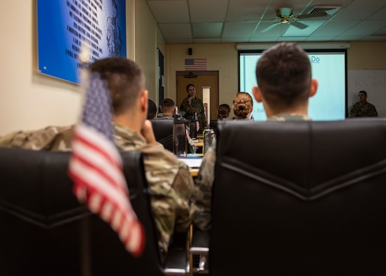 Staff Sgt. Kristine MacDonald, 325th Fighter Wing Public Affairs broadcast journalist, briefs a group of Airmen during the First Term Airmen Course at Tyndall Air Force Base, Florida, June 21, 2019. MacDonald briefed the Airmen on the importance of appropriate social media use. (U.S. Air Force photo by Airman 1st Class Bailee A. Darbasie)