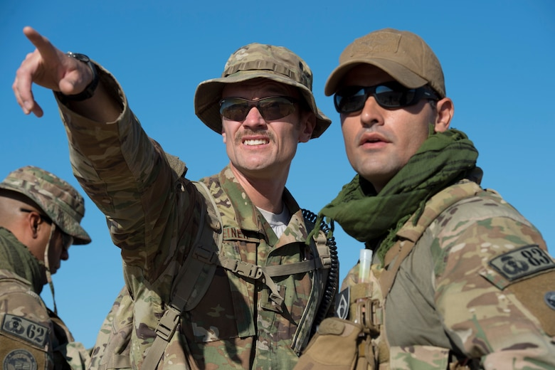 Capt. Robert Steiner, a tactical air control party specialist assigned to the 124th Air Support Operations Squadron, Idaho Air National Guard, points out a target to a Brazilian Air Force TACP at the National Training Center, Fort Irwin, California, June 12, 2019. The Brazilian Air Force was training with the 124 ASOS TACPs and the 12th Combat Training Squadron TACPS during NTC. (U.S. Air National Guard photo by Senior Airman Mercedee Wilds)