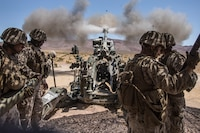 U.S. Marines with November Battery, 5th Battalion, 14th Marine Regiment, 4th Marine Division operate an M777 Howitzer during Integrated Training Exercise 4-19 at Marine Corps Air Ground Combat Center Twentynine Palms, Calif., June 14, 2019. ITX is a live-fire and maneuver combined arms exercise designed to train battalion and squadron-sized units in tactics, techniques, and procedures required to provide a sustainable and ready operational reserve for employment across the full spectrum of crisis and global engagement.