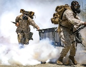 U.S. Marines with 3rd Platoon, 11th Marine Regiment, 1st Marine Division, run during a simulated chemical, biological, radioactive, and nuclear attack for the Command Sponsored Corporals Course, at Marine Corps Base Camp Pendleton, California, June 19, 2019. The CSCC was hosted by 11th Marine Regiment, 1st Marine Division, to provide students with basic knowledge and skills to become successful small-unit leaders.