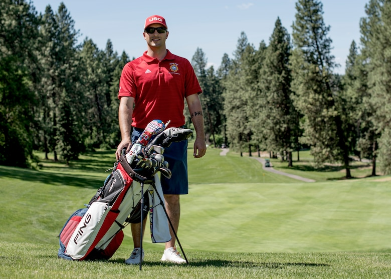 U.S. Air Force Staff Sgt. Dolton Dishman, 92nd Operations Support Squadron flotation equipment NCO in charge, poses for a photo at Indian Canyon Golf Course in Spokane, Washington, May 14, 2019. Dishman recently participated in the 2019 Armed Forces Golf Championship, qualifying for the 7th Conseil International du Sport Militaire Military World Games in China. (U.S. Air Force photo by Airman 1st Class Whitney Laine)