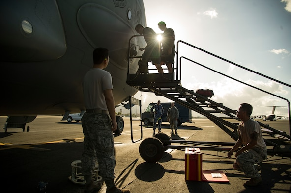 Maintainers from the 15th Maintenance Group and members from the 36th Squadron, Royal Australian Air Force Base Amberley, perform maintenance on a C-17 Globemaster III at Joint Base Pearl Harbor-Hickam, Hawaii, July 12, 2017. The recently implemented C-17 Aircraft Repair and Maintenance Services Implementing Arrangement enables U.S. and Australian C-17 maintainers to perform full, interoperable cross-maintenance on U.S. or Australian C-17s at mission critical times on a global scale, improving aircraft availability and decreasing aircraft maintenance downtime and maintenance recovery expenses. (U.S. Air Force photo by Tech. Sgt. Heather Redman)