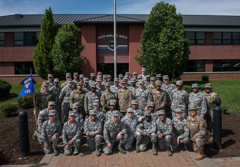 Citizen Airmen in the 932nd Force Support Squadron gather for a squadron photo in front of the 932nd Airlift Wing headquarters building, May 5, 2019, Scott Air Force Base, Illinois. (U.S. Air Force photo by Master Sgt. Christopher Parr)