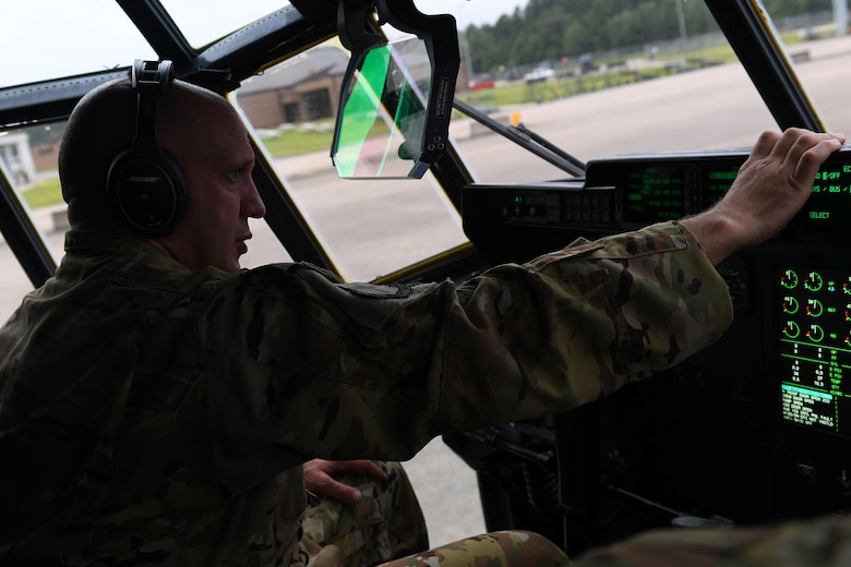 An Airman prepare for take-off in a C-130J