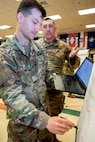 U.S. Army Capts. Joshua Witherell, 368th Financial Management Support Unit Detachment 2 commander, left, and Jared Viernes, 368th Financial Management Support Unit commander, work through a problem during an Army Reserve Company Leader Development Course at Fort McCoy, Wisconsin, June 20, 2019. CLDC teaches officers and noncommissioned officers leadership fundamentals and gives them tools to maximize training and effectiveness.