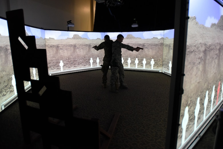 Members of the North Carolina (NC) and Louisiana (L) Air National Guard (ANG) conduct use of force and tactical situational practice in a Fire Arms Training Simulator simulator June 12, 2019 at the 176th Security Forces Squadron in Anchorage, AK. The 145th Security Forces and 263rd Combat Communications Squadrons with the NCANG, and the 159th Security Forces Squadron with the LANG travel to Joint Base Elmendorf-Richardson to train on various tactical and strategic law enforcement procedures during annual training.