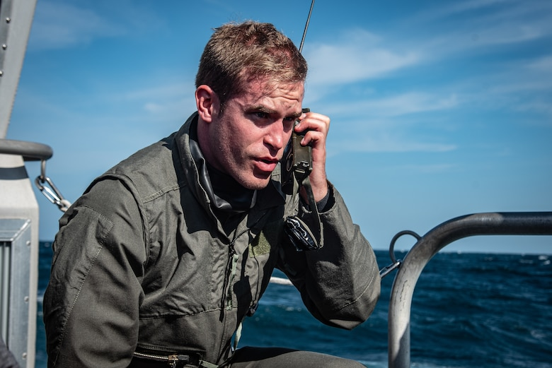 U.S. Air Force Capt. Kyle Rasmussen, 55th Fighter Squadron pilot, makes a mayday call during a search-and-recovery exercise off the coast of Tybee Island Coast Guard Station, Georgia, June 21. 2019.