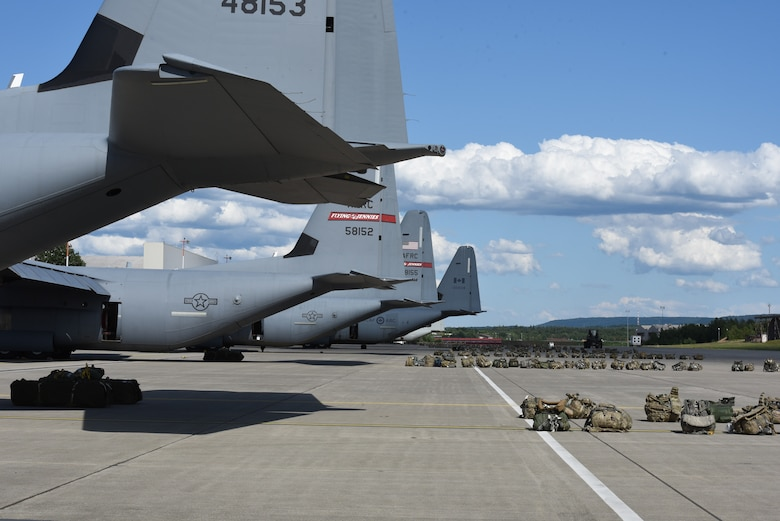 Army ruck sacks sit behind the aircraft for the first airdrop of exercise Swift Response 19, June 13, 2019. The exercise is one of the premier military crisis response training events featuring high readiness airborne forces from eight NATO nations. Activities include intermediate staging base operations, multiple airborne operations, and several air assault operations. The Swift Response exercises have had great success in creating a foundation for the strong relationships we share with several European allies and partners today. (U.S. Air Force photo by Master Sgt. Jessica Kendziorek)