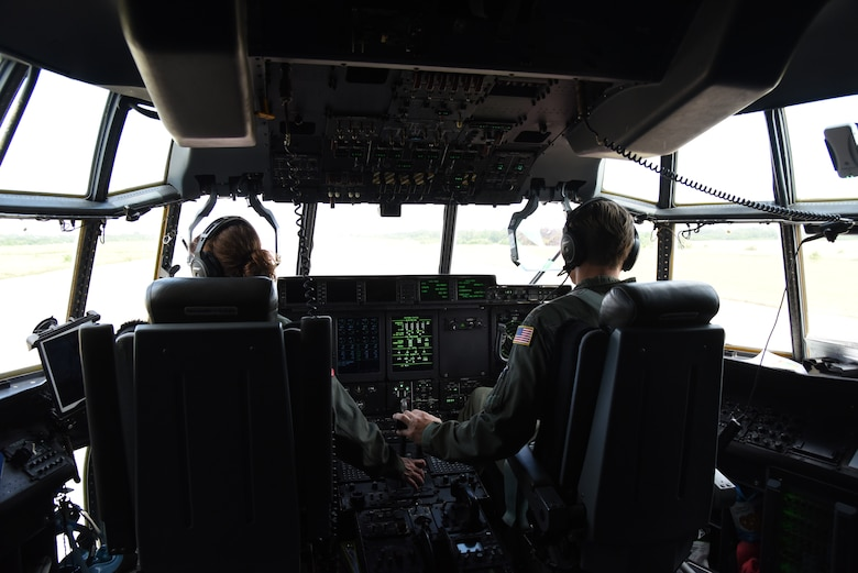 Lt. Col. Stephanie Brown and Maj. Ben Jones, pilots for the 815th Airlift Squadron from the 403rd Wing, throttle the C-130J for takeoff after completing the air/land mission for exercise Swift Response 19, June 19, 2019. The exercise is one of the premier military crisis response training events featuring high readiness airborne forces from eight NATO nations. Activities include intermediate staging base operations, multiple airborne operations, and several air assault operations. The Swift Response exercises have had great success in creating a foundation for the strong relationships we share with several European allies and partners today. (U.S. Air Force photo by Master Sgt. Jessica Kendziorek)