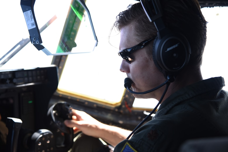 Maj. Ben Jones, pilot for the 815th Airlift Squadron from the 403rd Wing, checks the instruments and flight path for the air/land missionfor exercise Swift Response 19, June 19, 2019. The exercise is one of the premier military crisis response training events featuring high readiness airborne forces from eight NATO nations. Activities include intermediate staging base operations, multiple airborne operations, and several air assault operations. The Swift Response exercises have had great success in creating a foundation for the strong relationships we share with several European allies and partners today. (U.S. Air Force photo by Master Sgt. Jessica Kendziorek)