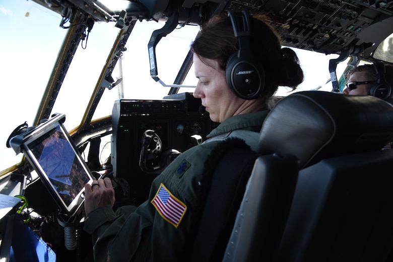 Lt. Col. Stephanie Brown, pilot for the 815th Airlift Squadron from the 403rd Wing, checks the instruments and flight path for the air/land mission for exercise Swift Response 19, June 19, 2019. The exercise is one of the premier military crisis response training events featuring high readiness airborne forces from eight NATO nations. Activities include intermediate staging base operations, multiple airborne operations, and several air assault operations. The Swift Response exercises have had great success in creating a foundation for the strong relationships we share with several European allies and partners today. (U.S. Air Force photo by Master Sgt. Jessica Kendziorek)