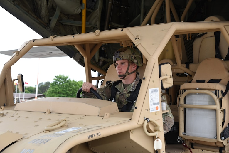 Army Corporal Jared Guden, 82nd Airborne, scout platoon team leader, drives a ground mobility vehicle, off of a C-130J following the signals of the 815th loadmasters during preparations for exercise Swift Response 19, June 14, 2019. The exercise is one of the premier military crisis response training events featuring high readiness airborne forces from eight NATO nations. Activities include intermediate staging base operations, multiple airborne operations, and several air assault operations. The Swift Response exercises have had great success in creating a foundation for the strong relationships we share with several European allies and partners today. (U.S. Air Force photo by Master Sgt. Jessica Kendziorek)