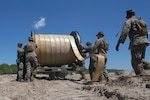 U.S. Marines with Bulk Fuel Company, 8th Engineer Support Battalion, 2nd Marine Logistics Group, utilize a hose-reel system to lay down a fuel line during a Bulk Fuel exercise at Camp Lejeune, N.C., June 19, 2019. The Marines with 8th ESB ran fuel lines, patrolled the fuel sites and provided all around security to remain proficient in fueling support operations. (U.S. Marine Corps photo by Lance Cpl. Adaezia L. Chavez)