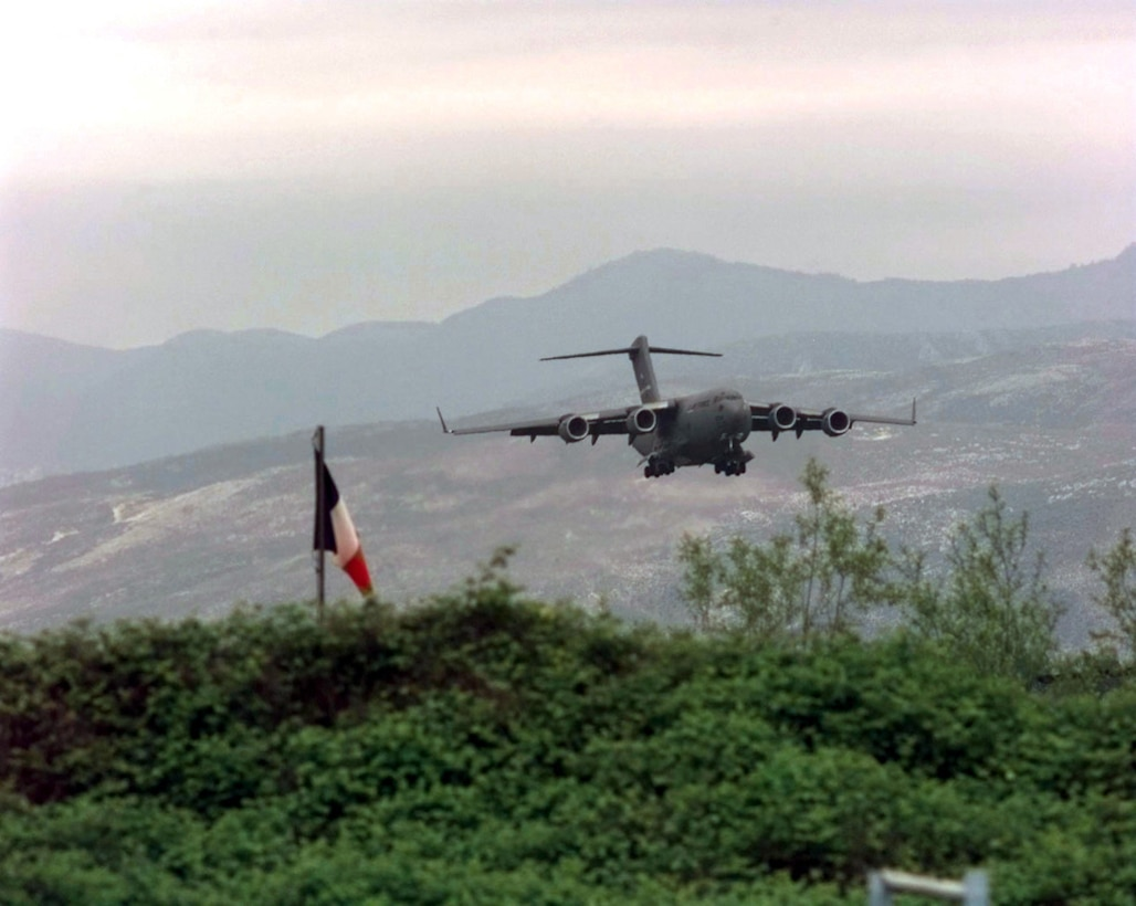 A U.S. Air Force C-17 Globemaster III from Joint Base Charleston makes its final approach to Rinas Airport in Albania during Operation Shining Hope, April 23, 1999. Medical Airmen provided humanitarian support for ethnic Albanian refugees fleeing Kosovo (U.S. Air Force photo by Tech. Sgt. Cesar Rodriguez)