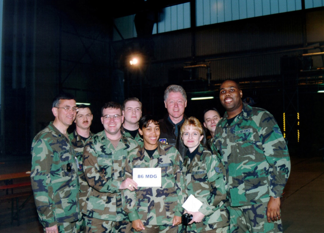 Former President William Jefferson Clinton poses for a photo with a member of the 86th Medical Group, Ramstein Air Base, Germany, during a dinner held at the base, on May 5, 1999. The former President visited Ramstein Air Base to thank the troops for their support of Operations Allied force and Sustain Hope. (U.S. Air Force photo by Senior Airman Brian Biosvert)