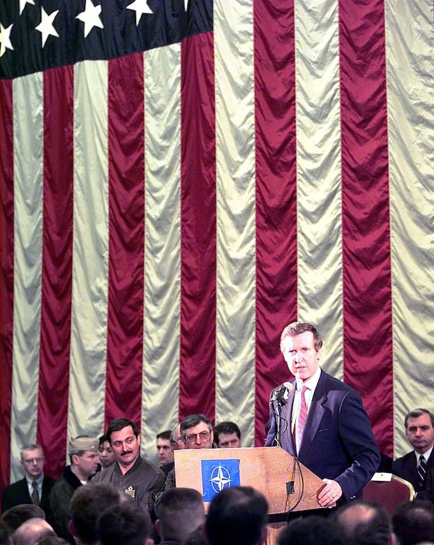Former Defense Secretary William S. Cohen addresses personnel stationed and deployed to Aviano Air Base, Italy, supporting NATO Operation Allied Force, April 8, 1999. In a report to Congress on the operations in the following January, Cohen recognized the efforts of the Air Force Medical Service. (U.S. Air Force photo by Senior Airman Stan Parker)