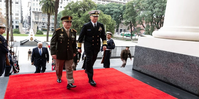 Military leaders walk.