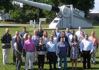 IMAGE: DAHLGREN, Va. (June 20, 2019) - New first-line supervisors from divisions across the Naval Warfare Centers are pictured at the 16-inch naval gun during their tour of Naval Surface Warfare Center Dahlgren Division (NSWCDD). They completed a five-day course called 'Propel' that provides an introductory level awareness of Warfare Center expectations for supervisors. The NSWCDD tour and briefings - focusing on the Electromagnetic Railgun Facility, the Potomac River Test Range, and the Human Performance Laboratory - gave the Propel students a deeper look into the work at Dahlgren. Meanwhile, they have been increasing their collaboration and understanding of operations throughout the Warfare Centers. (U.S. Navy photo/Released)