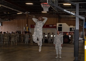U.S. Air Force Airmen 1st Class Cody Shelton, left, and Rico Polk, 60th Civil Engineer Squadron electrical system technicians, play one-on-one basketball June 24, 2019, at Travis Air Force Base, California. The Airmen engaged in an impromptu basketball game prior to a squadron group photo. The Air Force Fitness Program's goal is to motivate Airmen to participate in a year-round physical conditioning program that emphasizes total fitness, including proper aerobic conditioning, strength and flexibility training and healthy eating. Health benefits from an active lifestyle increases productivity, optimizes health and decreases absenteeism while maintaining a higher level of readiness. (U.S. Air Force photo by Heide Couch)