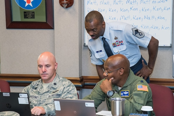 Retired Senior Master Sgt. James Core III, an Air Force Junior ROTC instructor at Cypress Ridge High School, Houston, Texas, assists new instructors, June 20, during the Air Force Junior ROTC Instructor Certification Course held at the Air Force Senior NCO Academy at Maxwell-Gunter Air Force Base, Alabama, June 12-21, 2019. Core was named the 2019 Air Force Junior ROTC Instructor of the Year, Aerospace Science Instructor category. (U.S. Air Force photo by William Birchfield)