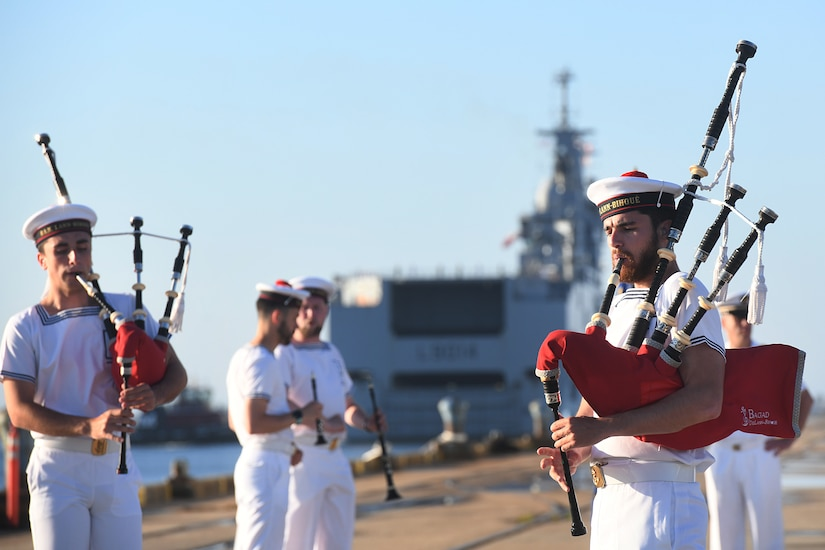 Marine Nationale (French Navy) Sailors perform as Landing Helicopter Dock Tonnerre navigates toward the Columbus Terminal Port as part of a deployment stopover June 21, 2019, in Charleston, S.C. U.S. Navy Cmdr. Patrick Sutton, Naval Support Activity Charleston executive officer and 628th Mission Support Group deputy commander, spoke with leaders of LHD Tonnerre to ensure the crew received support during their stay in Charleston. Engagements such as this provide opportunities to strengthen partnerships between allies.