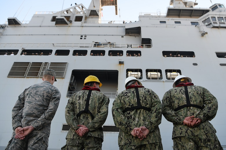 U.S. service members watch the Marine Nationale (French Navy) Landing Helicopter Dock Tonnerre navigate into the Columbus Terminal Port as part of a deployment stopover June 21, 2019, in Charleston, S.C. U.S. Navy Cmdr. Patrick Sutton, Naval Support Activity Charleston executive officer and 628th Mission Support Group deputy commander, spoke with leaders of LHD Tonnerre to ensure the crew received support needed while in Charleston. Engagements such as this provide opportunities to strengthen partnerships between allies.