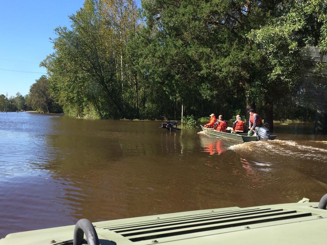 Deputies use their Humvee to travel Dobson Chapel Rd. during Hurricane Matthew.
