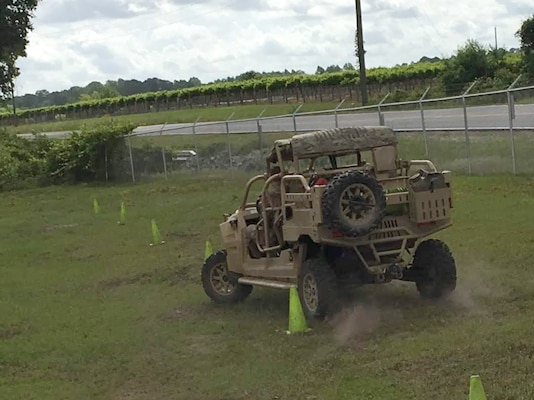 Deputy Jerry Griffin trains on the serpentine course in the tactical dune buggy used to handle challenging terrain.