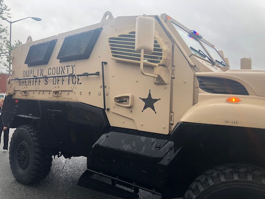 Nurse Heather Maready helps deputies move incoming patients from the rear of the MRAP for emergency care during Hurricane Florence.