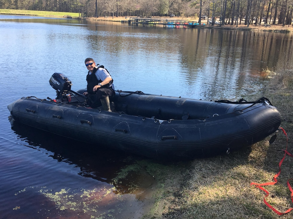 Deputy Jerry Griffin helps test one of the Zodiac boats after they were received at Duplin County.