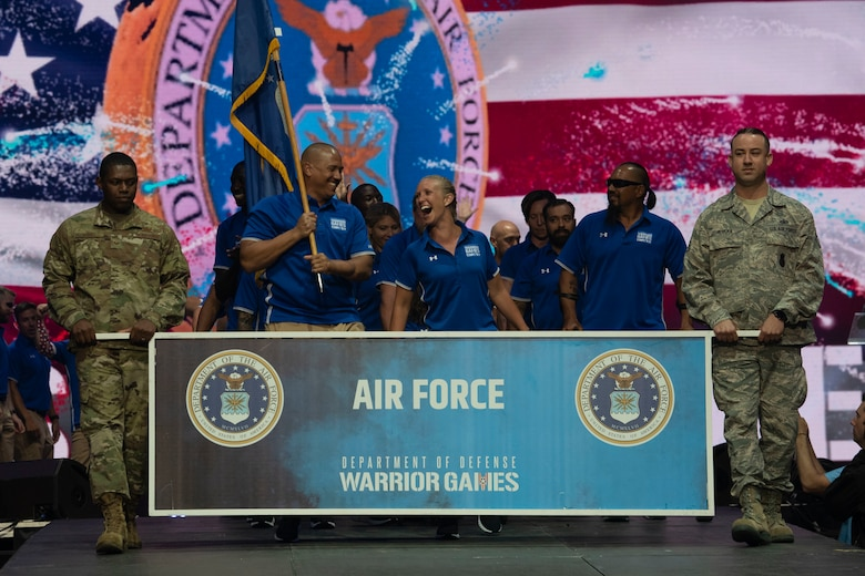 Air Force athletes enter the arena for the opening ceremony of the Department of Defense Warrior Games in Tampa Bay, Fla., June 22, 2019. (DoD photo by Lisa Ferdinando)
