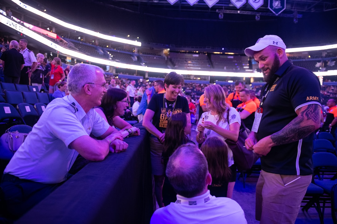 U.S. Air Force Gen. Paul J. Selva, vice chairman of the Joint Chiefs of Staff, chats with athletes and their families during the 2019 Department of Defense Warrior Games Opening Ceremony in Tampa Bay, Fla., June 22, 2019. Approximately 300 wounded, ill and injured service members and veterans will participate in 13 athletic competitions over 10 days as U.S. Special Operations Command hosts the 2019 DoD Warrior Games. (DoD photo by U.S. Army Sgt. James K. McCann)