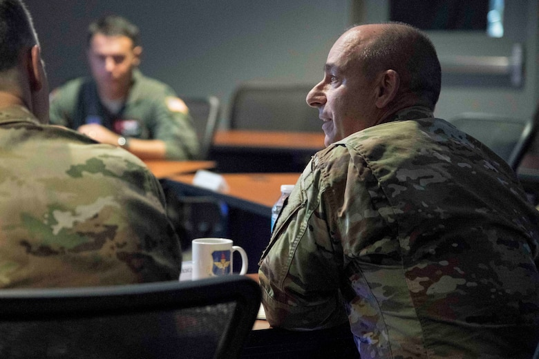 Gen. Jeffrey L. Harrigian, United States Air Forces Europe and United States Air Forces Africa commander, listens during a briefing on the training capabilities of Pilot Training Next during a visit to Detachment 24 at Joint Base San Antonio-Randolph, Texas, June 24, 2019.  PTN is an Air Education and Training Command program to explore and prototype a pilot training environment that integrates various technologies to produce pilots in a learning-focused manner. (U.S. Air Force photo by Sean M. Worrell)
