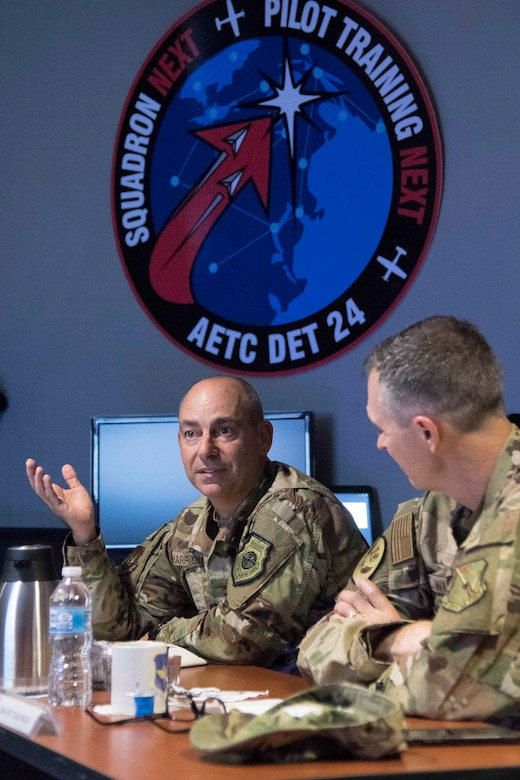 Gen. Jeffrey L. Harrigian, United States Air Forces Europe and United States Air Forces Africa commander, asks questions during a briefing on the training capabilities of Pilot Training Next during a visit to Detachment 24 at Joint Base San Antonio-Randolph, Texas, June 24, 2019. PTN is an Air Education and Training Command program to explore and prototype a pilot training environment that integrates various technologies to produce pilots in a learning-focused manner. (U.S. Air Force photo by Sean M. Worrell)