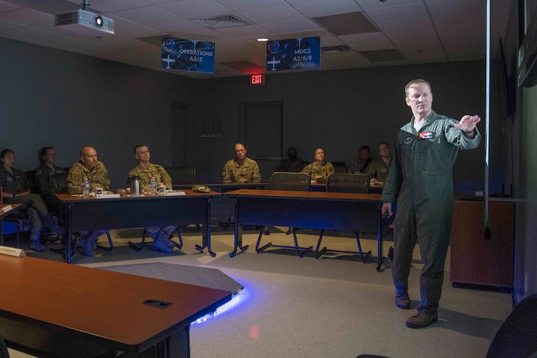 Lt. Col. Matthew Strohmeyer, Detachment 24 commander, briefs Gen. Jeffrey L. Harrigian, United States Air Forces Europe and United States Air Forces Africa commander, on the establishment of a resilient mesh network and its capabilities, during a visit to Detachment 24 at Joint Base San Antonio-Randolph, Texas, June 24, 2019.  Det. 24 will utilize Learning Next initiatives to examine how Air Education and Training Command members have historically trained Airmen and then will identify potential solutions to modernize flying and technical training pipelines, and training practices across various communities to produce qualified Airmen in a learning-focused manner. (U.S. Air Force photo by Sabrina Fine)