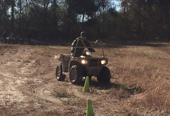 Deputy Billy Smith hones his skills on one of the Polaris 850 all-terrain vehicles.