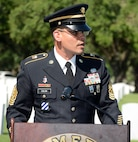 Command Sgt. Maj. Gilberto Colon, 187th Medical Battalion, was the guest speaker at the ceremony honoring retired Sgt. Maj. of the Army Leon Van Autreve June 21 at the Fort Sam Houston National Cemetery.