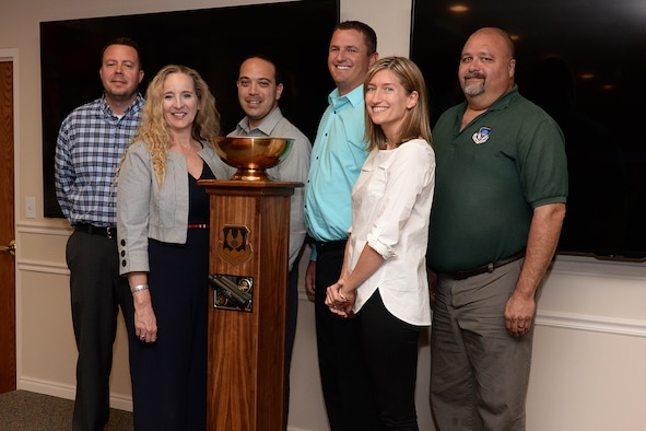 Aerospace Sustainment Directorate team members (left to right) Rich Kuykendall, Cathy Barker, Adam Payne, Braeden Stander, Jeni Owen and Lance Haycock receive the Logistics Airmen Mastering Possibilities, or L-A-M-P, Award trophy June 6, 2019, at Hill Air Force Base, Utah. The award established in January includes a traveling trophy and is presented monthly to the Ogden Air Logistic Complex's most deserving team or unit. (U.S. Air Force photo by Alex R. Lloyd)