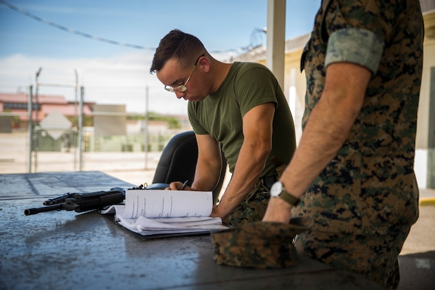 U.S. Marine Corps Lance Cpl. Tyler Huckleberry and U.S. Navy sailor HM2 David Manley, with Headquarters & Headquarters Squadron Marine Corps Air Station (MCAS) Yuma, conduct weapons training in order to qualify for the Enlisted Fleet Marine Force Warfare Specialist device on MCAS Yuma, June 11, 2019. In order to be awarded the device a sailor must complete the Fleet Marine Force Qualification Training in order to familiarize themselves with the Marine Corps. (U.S. Marine Corps photo by Lance Cpl. John Hall)