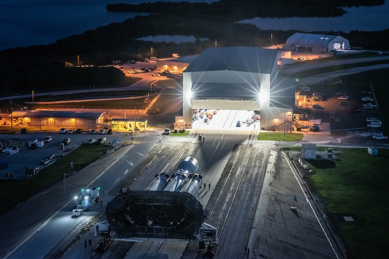 A SpaceX Falcon Heavy launch vehicle rolls out of its assembly hangar in the pre-dawn hours of June 24, 2019 for the short trip up to the historic Launch Complex-39A at NASA's Kennedy Space Center. (Photo: SpaceX)