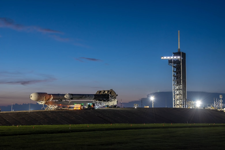 A SpaceX Falcon Heavy launch vehicle atop the Mobile Strongback Transporter, containing the Space Test Program-2 payloads encapsulated within the protective fairing, rolls up to position at Launch Complex-39A at NASA's Kennedy Space Center. (Photo: SpaceX)